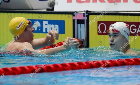Stock Photo of China's Sun Yang, right, is congratulated by Australia's Jack McLoughlin after winning the men's 400m freestyle final at the World Swimming Championships in Gwangju, South Korea