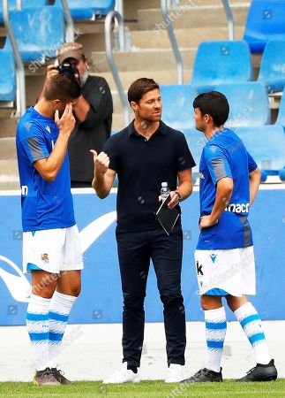 Former Spanish soccer player Xabi Alonso (C) gives instructions to his players during his first match as head coach of Real Sociedad B team (Sanse) against SD Besain at Zubieta facilities in San Sebastian, Spain, 20 July 2019.
