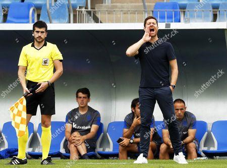 Former Spanish soccer player Xabi Alonso (R) reacts during his first match as head coach of Real Sociedad B team (Sanse) against SD Besain at Zubieta facilities in San Sebastian, Spain, 20 July 2019.