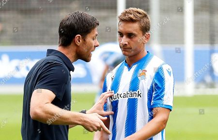Former Spanish soccer player Xabi Alonso (L) gives instructions to his player Marcos Celorrio (R) during his first match as head coach of Real Sociedad B team (Sanse) against SD Besain at Zubieta facilities in San Sebastian, Spain, 20 July 2019.