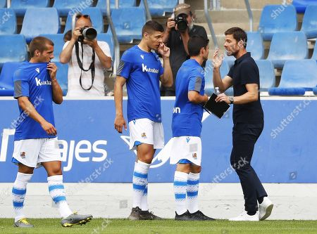 Stock Photo of Former Spanish soccer player Xabi Alonso (R) gives instructions to his players during his first match as head coach of Real Sociedad B team (Sanse) against SD Besain at Zubieta facilities in San Sebastian, Spain, 20 July 2019.