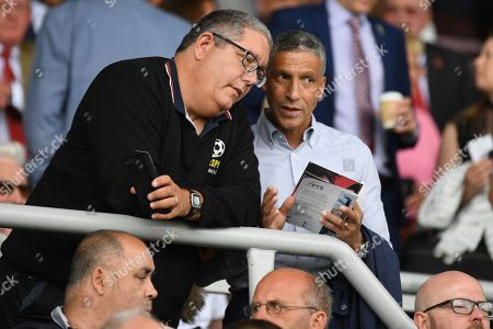 """Former Brighton manager Chris Hughton chats to Talksport presenter Ian """"The Moose"""" Abrahams during the Pre-Season Friendly match between Northampton Town and Sheffield United at the PTS Academy Stadium, Northampton"""