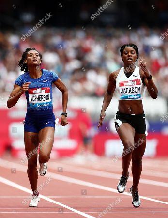 Stephanie Ann McPherson and Shericka Jackson of Jamaica during the Womens 400m.