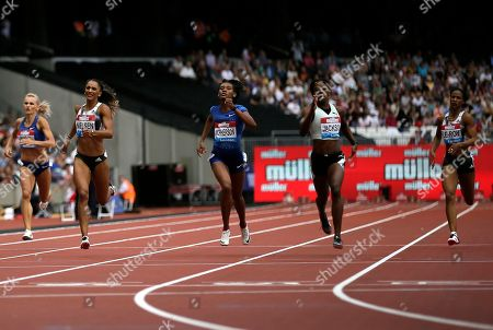 Shericka Jackson of Jamaica, 2nd right, crosses the finish line ahead of second placed Stephenie Ann McPherson of Jamaica, center, and third placed Laviai Nielsen of Britain, 2nd left, in the the women's 400 meters race at the IAAF Diamond League athletics meeting at London Stadium in London
