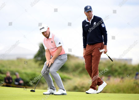 Tyrrell Hatton of England (L) and Matt Kuchar of the US on the green during the third day of the British Open Golf Championship at Royal Portrush, Northern Ireland, 20 July 2019.