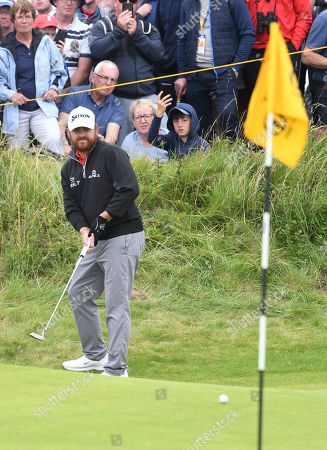 Stock Picture of JB Holmes of the US putts during the third day of the British Open Golf Championship at Royal Portrush, Northern Ireland, 20 July 2019.