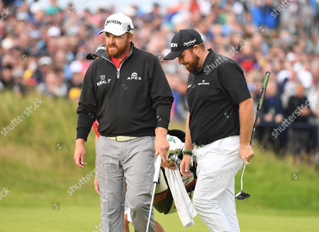Stock Photo of JB Holmes of the US (L) and Shane Lowry of Ireland approaching the 18th on the third day of the British Open Golf Championship at Royal Portrush, Northern Ireland, 20 July 2019.