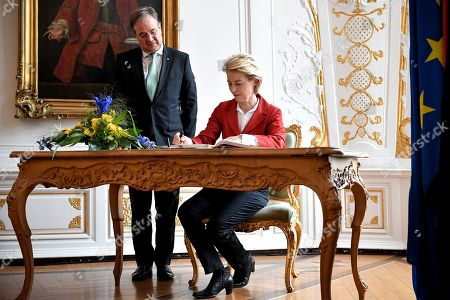 Ursula von der Leyen (R), President-elect of the European Commission, meets with Prime Minister of North Rhine-Westphalia Armin Laschet (L) and signs the guest book of the state government of North Rhine-Westphalia at the City Hall in Aachen, Germany, 20 July 2019. Von der Leyen, who was elected as president in the EU Parliament by a narrow margin, will become the first woman in the history of the EU to head the Commission from 01 November 2019.