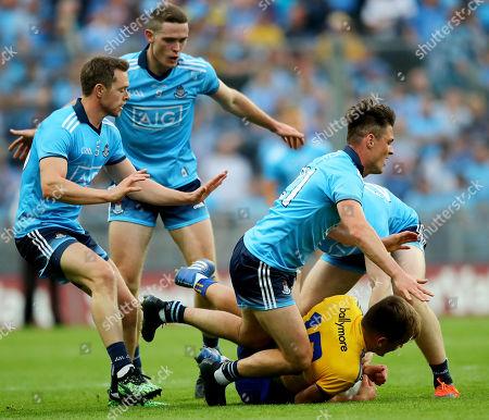 Dublin vs Roscommon. Dublin's Dean Rock, Brian Fenton, Eric Lowndes and Paddy Small tackle Enda Smith of Roscommon