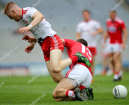 Stock Photo of Cork vs Tyrone. Tyrone's Cathal McShane and Mark Collins of Cork
