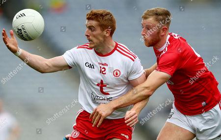 Cork vs Tyrone. Tyrone's Peter Harte and Killian O'Hanlon of Cork