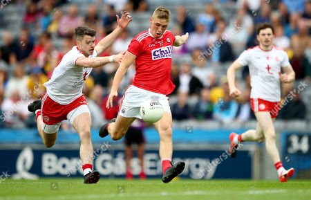 Cork vs Tyrone. Tyrone's Richard Donnelly and Sean White of Cork