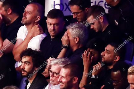 Jose Mourinho covers his face during the David Price v Dave Allen fight.