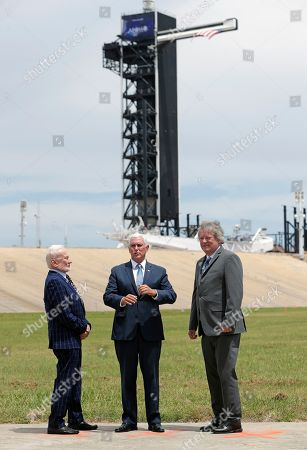 Buzz Aldrin, Mike Pence, Rick Armstrong. Apollo astronaut Buzz Aldrin, left, talks with Vice President Mike Pence, center, and Rick Armstrong, son of Apollo 11 astronaut Neil Armstrong as they gather at pad 39a the Kennedy Space Center where the launch of Apollo 11 took place 50 years ago on this anniversary of the moon landing, in Cape Canaveral, Fla