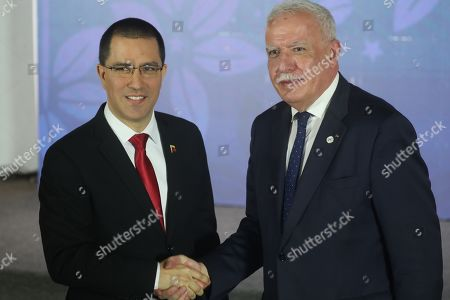 Venezuelan Foreign Affairs Minister Jorge Arreaza (L) greets Palestinian Minister of Foreign Affairs Riyad al-Maliki (R) during a meeting of the Non-Aligned Movement (NAM) coordination bureau, in Caracas, Venezuela, 20 July 2019.