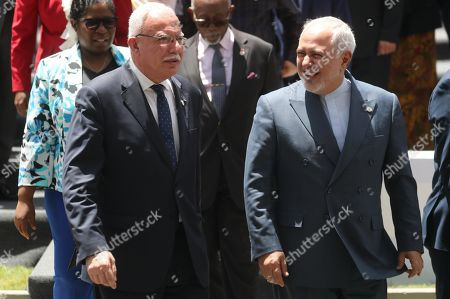 Iranian Minister of Foreign Affairs Mohammad Javad Zarif (R) talks to his Palestinian counterpart Riyad al-Maliki during a meeting of the Non-Aligned Movement (NAM) coordination bureau, in Caracas, Venezuela, 20 July 2019.
