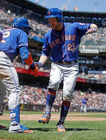New York Mets' Todd Frazier, right, celebrates with Dominic Smith after hitting a home run off San Francisco Giants' Derek Holland in the sixth inning of a baseball game, in San Francisco