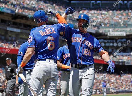 Pete Alonso, Jeff McNeil. New York Mets' Pete Alonso, right, celebrates with Jeff McNeil (6) after hitting a three-run home run off San Francisco Giants' Derek Holland in the sixth inning of a baseball game, in San Francisco