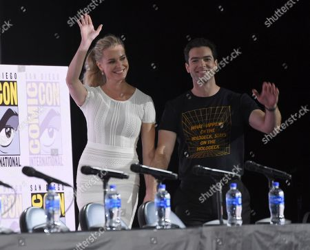 "Stock Image of Ethan Peck, Rebecca Romijn. Rebecca Romijn, left, and Ethan Peck wave to the audience as they walk on stage at the ""Star Trek: Discovery"" portion of the Enter the ""Star Trek"" Universe panel on day three of Comic-Con International, in San Diego"