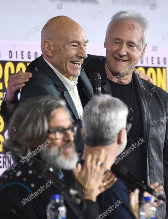 """Patrick Stewart, Brent Spiner. Patrick Stewart, left, and Brent Spiner hug on stage at the """"Star Trek: Picard"""" portion of the Enter the """"Star Trek"""" Universe panel on day three of Comic-Con International, in San Diego"""