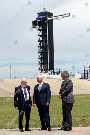 Apollo astronaut Buzz Aldrin, left, talks with Vice President Mike Pence and Rick Armstrong, son of Apollo 11 astronaut Neil Armstrong as they gather at pad 39a at the Kennedy Space Center where the launch of Apollo 11 took place 50 years ago on this anniversary of the moon landing, in Cape Canaveral, Fla