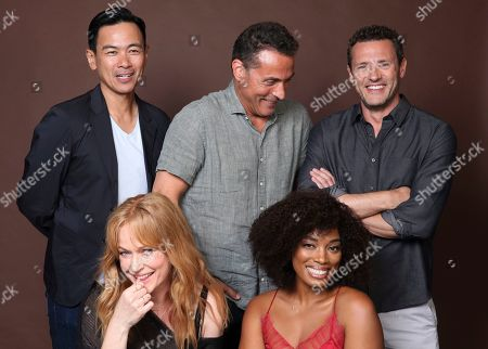 "Joel de la Fuente, Rufus Sewell, Jason O'Mara, Chelah Horsdal, Frances Turner. Joel de la Fuente, from back row left, Rufus Sewell, Jason O'Mara, and from front row left, Chelah Horsdal and Frances Turner pose for a portrait to promote the television series ""The Man in the High Castle"" on day three of Comic-Con International, in San Diego"