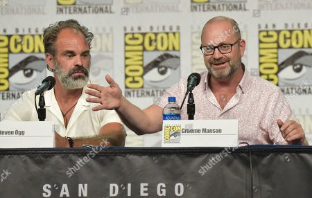 "Steven Ogg, Graeme Manson. Steven Ogg, left, and Graeme Manson participate in the ""Snowpiercer"" panel on day three of Comic-Con International, in San Diego"