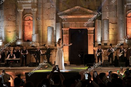 Stock Photo of Nancy Ajram performs during the 2019 Jerash Festival of Culture and Arts at the Jerash archeological site, Jerash, some 46 km North of Amman, Jordan, 20 July 2019. The Jerash festival takes part from 18 to 27 July 2019.