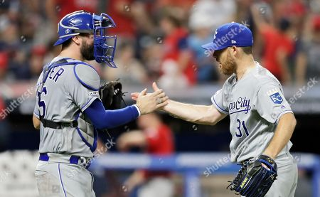 Cam Gallagher, Ian Kennedy. Kansas City Royals relief pitcher Ian Kennedy, right, is congratulated by catcher Cam Gallagher after the Royals defeated the Cleveland Indians 1-0 in a baseball game, in Cleveland