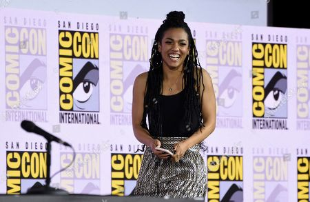 Freema Agyeman walks on stage at the EW: Women Who Kick Ass panel on day three of Comic-Con International, in San Diego