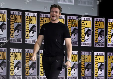 Richard Madden walks on stage at the Marvel Studios panel on day three of Comic-Con International, in San Diego