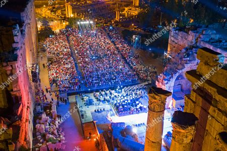 Stock Photo of Fans attend a concert of Palestinian singer Mohammed Assaf as he performs on stage during the annual Baalbeck International Festival (BIF) in Baalbeck, Beqaa Valley, Lebanon, 20 July 2019. The festival runs from 05 July to 03 August 2019.