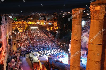 Fans attend a concert of Palestinian singer Mohammed Assaf as he performs on stage during the annual Baalbeck International Festival (BIF) in Baalbeck, Beqaa Valley, Lebanon, 20 July 2019. The festival runs from 05 July to 03 August 2019.