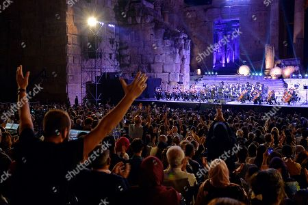 Stock Picture of Fans attend a concert of Palestinian singer Mohammed Assaf as he performs on stage during the annual Baalbeck International Festival (BIF) in Baalbeck, Beqaa Valley, Lebanon, 20 July 2019. The festival runs from 05 July to 03 August 2019.