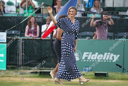 Tennis Hall of Fame inductee Mary Pierce of France waves to the crowd as she is introduced during ceremonies at the International Tennis Hall of Fame, in Newport, R.I