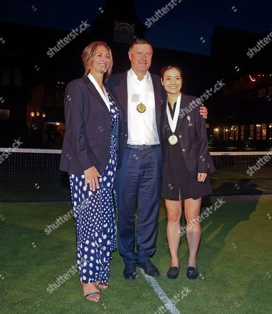 Tennis Hall of Fame inductees, from left, Mary Pierce of France, Yevgeny Kafelnikov of Russia and Li Na of China pose for photos following induction ceremonies at the International Tennis Hall of Fame, in Newport, R.I