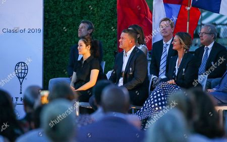 Tennis Hall of Fame inductees, from left, Li Na, of China, Yevgeny Kafelnikov, of Russia, and Mary Pierce, of France, listen during ceremonies at the International Tennis Hall of Fame, in Newport, R.I
