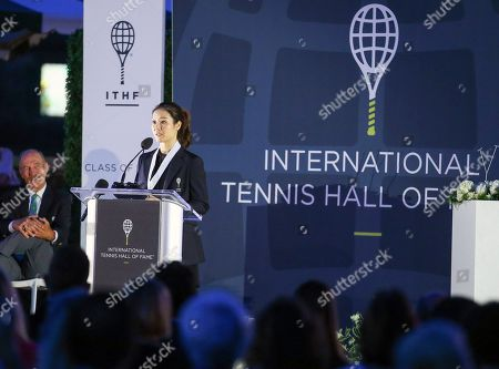 Tennis Hall of Fame inductee Li Na, of China, speaks to the crowd during ceremonies at the International Tennis Hall of Fame, in Newport, R.I