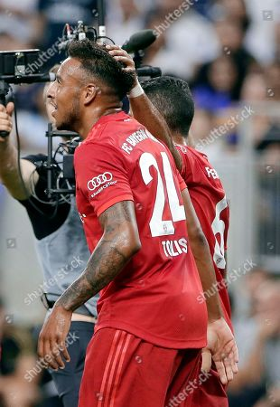 FC Bayern's Corentin Tolisso (24) gets a pat on the head from Thiago Alcantara after scoring a goal against Real Madrid during the first half of an International Champions Cup soccer match, in Houston