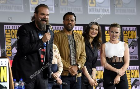 "David Harbour, O. T. Fagbenle, Rachel Weisz, Scarlett Johansson. David Harbour, from left, O. T. Fagbenle, Rachel Weisz and Scarlett Johansson participate during the ""Black Widow"" portion of the Marvel Studios panel on day three of Comic-Con International, in San Diego"