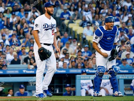 Austin Barnes, Clayton Kershaw. Los Angeles Dodgers catcher Austin Barnes, right, yells as he watches starting pitcher Clayton Kershaw's throw to first go off target on a single by Miami Marlins' Martin Prado during the fourth inning of a baseball game, in Los Angeles. Kershaw had a no-hitter going up until that point
