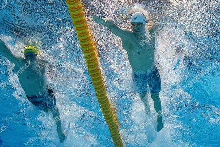 Yang Sun (R) of China and Jack McLoughlin (L) of Australia compete during the Men's 400m Freestyle heats at the 2019 FINA World Championships in Gwangju, South Korea, 21 July 2019.