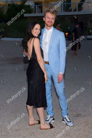 Claudia Sulewski, Finneas O'Connell. Claudia Sulewski, left, and Finneas O'Connell attend Chanel's J12 Yacht Club dinner event at Sunset Beach, in Shelter Island, NY