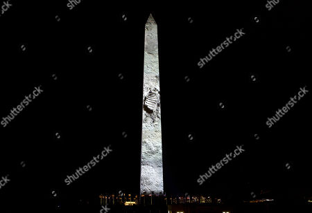Neil Armstrong foot print on the rocky Moon is projected on the Washington Monument, during the 50th anniversary of the Apollo 11 moon landing festivities at the National Mall in Washington