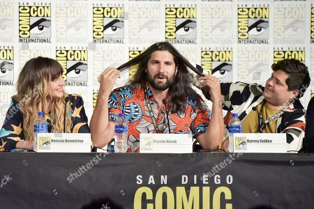 """Natasia Demetriou, Kayvan Novak, Harvey Guillen. Natasia Demetriou, from left, Kayvan Novak and Harvey Guillen participate in the """"What We Do in the Shadows"""" panel on day three of Comic-Con International, in San Diego"""