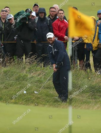 Stock Photo of J. B. Holmes of the United States plays to the 2nd green during the final round of the British Open Golf Championships at Royal Portrush in Northern Ireland