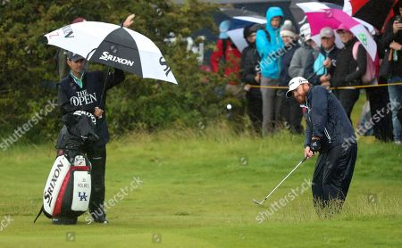J. B. Holmes of the United States chips onto the 10th green during the final round of the British Open Golf Championships at Royal Portrush in Northern Ireland