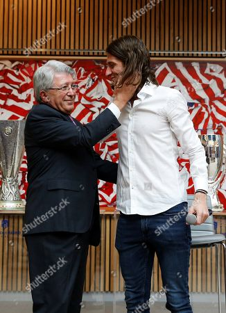 Brazilian defender Filipe Luis (R) poses for the media with Atletico de Madrid's president Enrique Cerezo (L) during a farewell press conference at Wanda Metropolitano stadium in Madrid, Spain, 21 July 2019. Filipe Luis leaves Atletico de Madrid after playing eight seasons in two different stages and will join with Flamengo from Brazil.