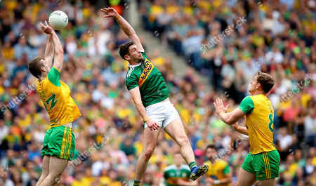 Kerry vs Donegal. Kerry's Paul Geaney with Hugh McFadden and Caolan Ward of Donegal