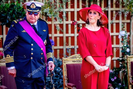 Prince Laurent, the brother of the Belgian King Philippe, was quite busy with his telephone during the military parade in Brussels as he sits alongside his wife Princess Claire.